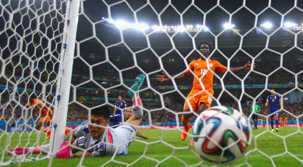 Gervinho of the Ivory Coast scores on a header past Eiji Kawashima of Japan as Wilfried Bony of the Ivory Coast looks on during the 2014 FIFA World Cup Brazil Group C match between the Ivory Coast and Japan at Arena Pernambuco on June 14, 2014 in Recife, Brazil. Photo: Getty Images