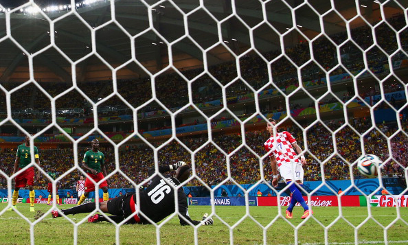 Mario Mandzukic of Croatia scores his team's fourth goal, his second, past Charles Itandje of Cameroon during the 2014 FIFA World Cup Brazil Group A match between Cameroon and Croatia at Arena Amazonia on June 19, 2014 in Manaus, Brazil. Photo: Getty Images