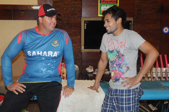 Bangladesh's new bowling coach Heath Streak enjoys a light moment with national captain Mushfiqur Rahim at the Sher-e-Bangla National Stadium in Mirpur yesterday. PHOTO: STAR