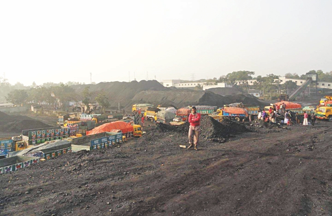 Huge quantity of coal lies stockpiled on the premises of Barapukuria Coal Mining Company Ltd in Dinajpur as sale and transport of the item was badly hampered due to political agitation like countrywide hartals and blockades by BNP-led opposition alliance during the peak selling period from September to December last year. PHOTO: STAR