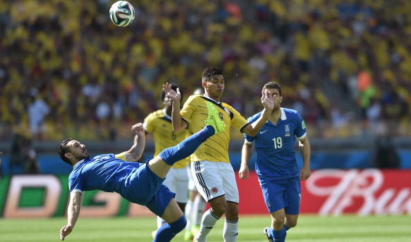 Greece's midfielder Kostas Katsouranis (L) in action during a Group C football match between Colombia and Greece at the Mineirao Arena in Belo Horizonte during the 2014 FIFA World Cup on June 14, 2014. Photo:  AFP/Getty Images