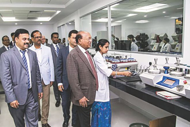 Commerce Minister Tofail Ahmed looks around after inaugurating Intertek's testing lab in Dhaka yesterday. Photo: INTERTEK