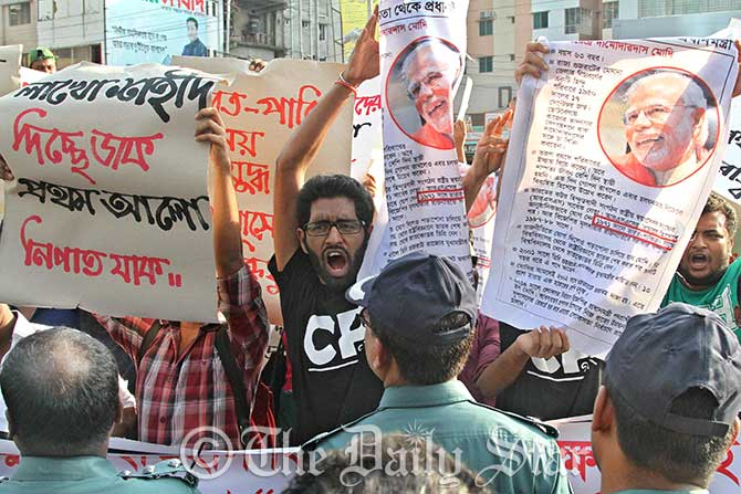 Agitated members of Facebook group, Crack Platoon, demonstrate in front of Prothom Alo office in capital's Karwan Bazar protesting the daily's alleged distortion of the history of Liberation War. Photo: Amran Hossain