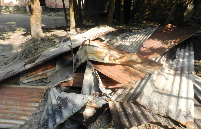 Criminals set the house of a Hindu family afire at Rayeshree village in Shahrasti upazila of Chandpur on Saturday night. Photo: Star