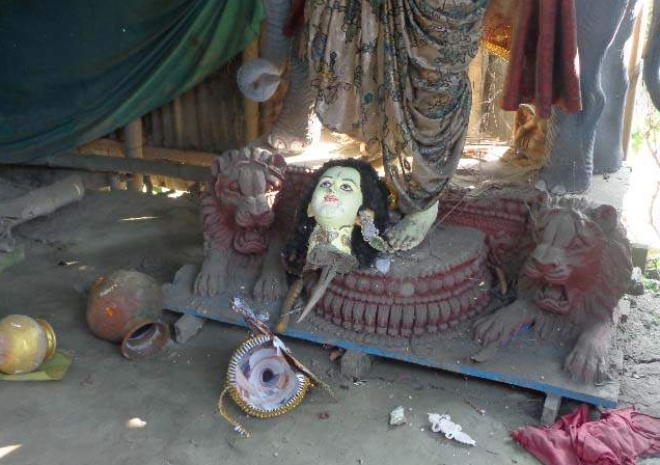 Criminals vandalise five idols at three temples in Sreenagar upazila of Munshiganj on Friday night. Photo shows a damaged idol at Shitala Temple at Paul Para of Shologhar in the upazila. Photo: Star