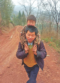 Dad carries son 18 miles to school