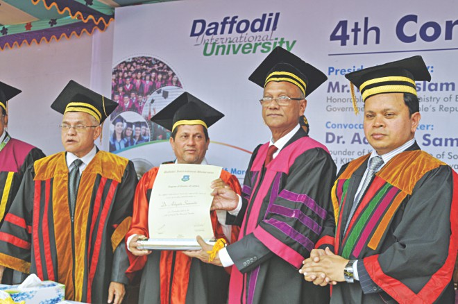 Education Minister Nurul Islam Nahid confers DLitt on Dr Achyuta Samanta at the 4th convocation of Daffodil International University held on its campus in Ashulia yesterday. On the far left is Vice Chancellor of Daffodil International University M Lutfar Rahman and on the far right is the university's Board of Trustees Chairman Sabur Khan.   Photo: Courtesy