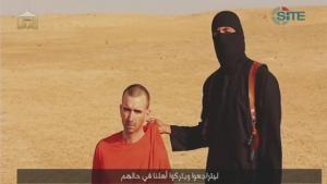 A video purportedly showing threats being made to a man Islamic State (IS) named as David Haines by a masked IS fighter in an unknown location in this still image from video released by Islamic State September 2, 2014. Photo: Reuters