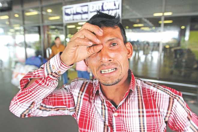 Deported Md Ilias in tears at Hazrat Shahjalal Airport yesterday. He spent several lakhs to go to Oman but did not even get a Tk 10,000 salary a month.  Photo: Palash Khan