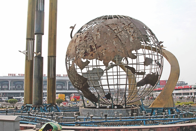 Chips of paint are falling off and rust has set in. This globe-shaped fountain in front of Shahjalal International Airport, the country's prime airport, is in this state due to sheer negligence. Photo: Sk Enamul Haq