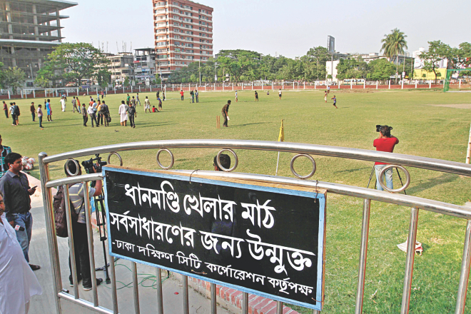 Dhaka South City Corporation hung a notice on the gate, opening the ground to all after two years.  Photo: Anisur Rahman