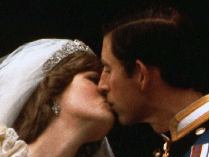 Prince Charles kisses his new bride Diana on their wedding day in London in a July 29, 1981 Reuters file photo.
