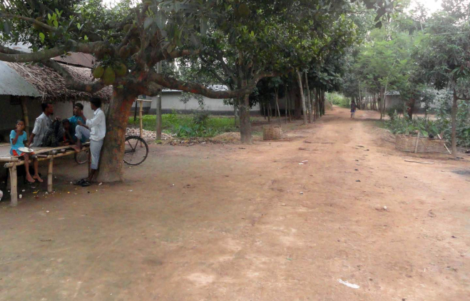 Khalippur village in Nawabganj upazila of Dinajpur wears a deserted look as most of the members of 60 Santal families of the village stay inside their houses, fearing fresh attacks by the criminals who brutally tortured four members of the community on May 9. The photo was taken on Wednesday. Photo: Star