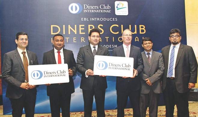 Hassan O Rashid, acting managing director of Eastern Bank, and John McCann, Diners Club International's regional managing director for Asia Pacific, display a Diners Club Card at a press conference at the Westin Dhaka yesterday. Nazeem A Choudhury, EBL consumer banking head; Rasel Hasan, head of cards; Subhrajit Basu, Diners Club's regional manager; and Sachin Khandelwal, deputy regional manager for South Asia, were also present. Photo: EBL