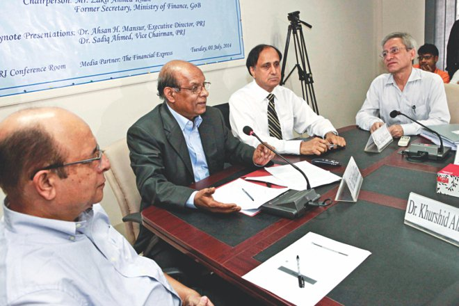Analysts attend a discussion on budget organised by the Policy Research Institute in association with DFID in Dhaka yesterday. Photo: Star