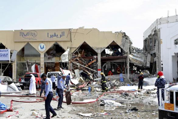 Rescue workers and policemen stand amidst debris near a Turkish restaurant following a gas explosion in Doha on February 27. Twelve people were killed, including two children, and about 30 wounded when a gas tank exploded at the Turkish restaurant in the Qatari capital off Doha on Thursday. Photo: Reuters