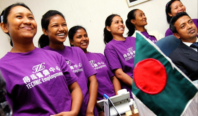 This May 14, 2013 photo shows fresh domestic helpers in Hong Kong (from left) Aongmapolle Marma, Paiching Marma, Murnn Har, Sarmen Akter Rima, Rokeya Akter and Hlanu Marma, with Bangladeshi consul general Mohammad Sarwar Mahmood. Photo courtesy: South China Morning Post