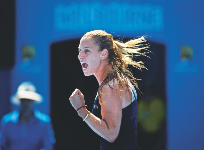 Slovakia's Dominika Cibulkova pumps her fist after winning a point against Poland's Agnieszka Radwanska during the Australian Open women's singles semifinal in Melbourne yesterday. PHOTO: AFP