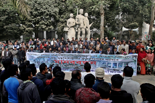 Dhaka University Teachers' Association forms a human chain in front of Aparajeya Bangla on the campus yesterday, protesting against the post-election attacks on the minority communities across several districts and immediate arrest and trial of the perpetrators. Photo: Star