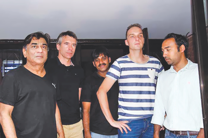 Dutch coaches Lodewijk de Kruif (2nd from L) and Rene Koster (2nd from R) emerge from a meeting with Bangladesh Football Federation president Kazi Salahuddin (L) and other BFF high-ups at the president's Gulshan residence yesterday. PHOTO: COURTESY