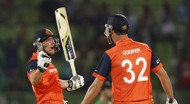 Netherlands' Ben Cooper (R) and Wesley Barresi celebrate their stunning victory against Ireland in their ICC World Twenty20 match at the Sylhet Cricket Stadium yesterday. Photo: AFP