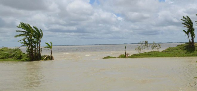 Saline water from Ramnabad River enters the villages and agricultural land through the breached portion of the flood control embankment in Lalua union under Kalapa upazila of Patuakhali. Photo: Star