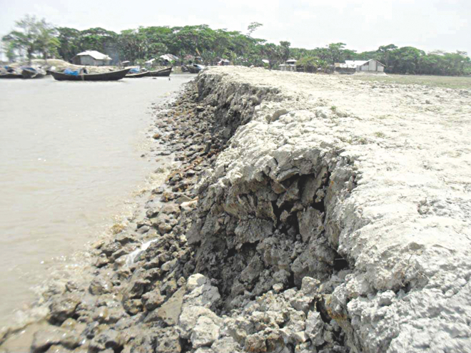 The recently built embankment on the Ramnabad River at Charipara village in Kalapara upazila under Patuakhali district gets eroded under the impact of tidal surges that occur frequently in the area near the Bay, thanks to the indifference of the authorities concerned who did not care about reinforcing the dyke with concrete blocks.  PHOTO: STAR