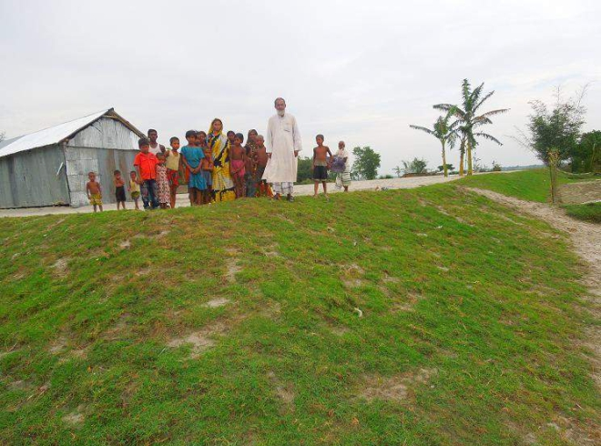 A newly constructed earthen 'killa', a safe place higher than usual floodwater level, at Kisamoter Char in Teesta River basin area in Dimla upazila of Nilphamari. UNDP provided financial, technical and monitoring support for construction of the shelter for people of the area in times of flood. Photo: Star