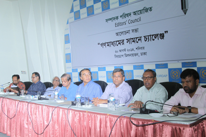From right, Shyamal Dutta, Shykh Seraj, Shawkat Mahmud, Mahfuz Anam, Golam Sarwar, Prof Serajul Islam Choudhury, Monjurul Ahsan Bulbul, and Barrister Amir-ul Islam at a discussion,