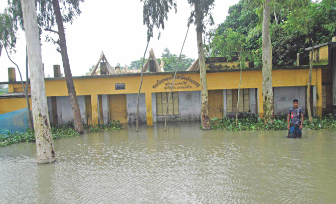 Flood water swamps Gozaria Government Primary School in Shariakandi upazila of Bogra. This is one of the 18 primary schools closed amid flood in the upazila. Photo: Star