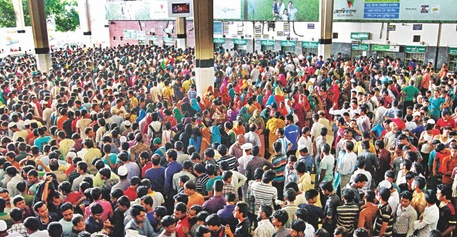 A sea of ticket-seekers before the counters at Kamalapur Railway Station in the capital yesterday with the special transport services for Eid home rush set to start today. Photo: Amran Hossain