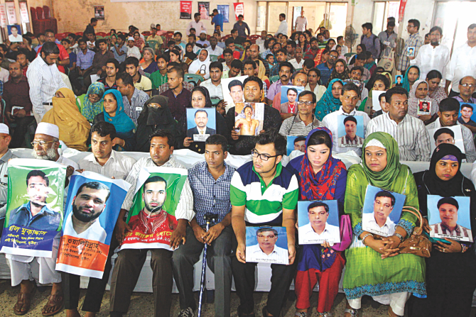 Family members of the people, who were allegedly made to disappear, hold posters and photos of their loved ones at the Jatiya Press Club marking the United Nation's International Day of the Victims of Enforced Disappearances. Photo: Palash Khan