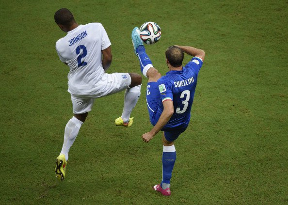 Italy's defender Giorgio Chiellini (R) and Italy's defender Mattia De Sciglio vie for the ball during a Group D football match between England and Italy at the Amazonia Arena in Manaus during the 2014 FIFA World Cup on June 14, 2014. Photo: AFP/Getty Images