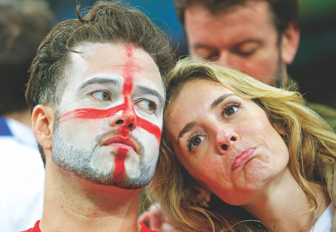 England's defeat is written on the faces of their fans. PHOTO: REUTERS