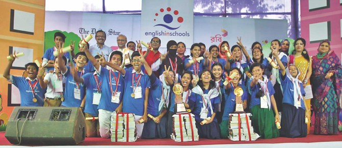 Winning students show the V sign at the Chittagong divisional round of English in Schools, a joint endeavour of The Daily Star and Robi, in the port city yesterday. Also present are, from left, Dr Salehuddin Ahmed, managing editor at The Daily Star, Prof Anwarul Azim Arif, vice chancellor of Chittagong University, and Sohel Ahmed, manager at Robi, Chittagong region.      Photo: Star