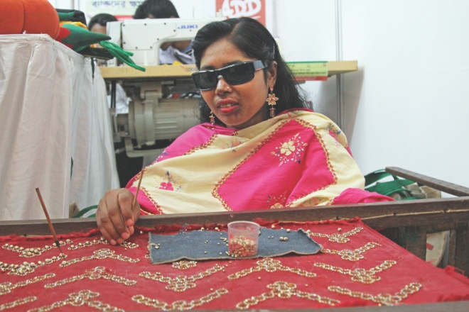 A visually impaired woman, beneficiary of a project implemented by Action on Disability and Development, participates in a fair co-organised by Shiree, Manusher Jonno Foundation and World Food Programme. Photo: Star