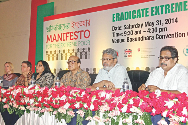 Shaheen Anam, executive director of Manusher Jonno Foundation, moderates a discussion on Eradicate Extreme Poverty Day 2014, at Bashundhara Convention Centre in Dhaka yesterday. Photo: Star