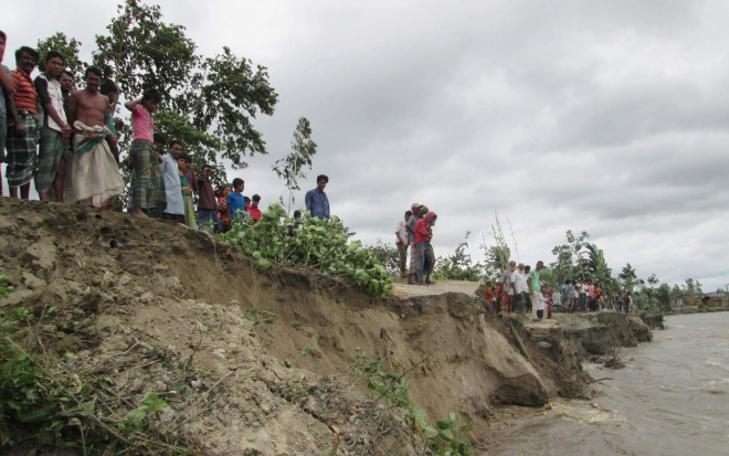 The flood control embankment in Rohodaha area in Sariakandi upazila of Bogra is on the verge of collapse due to constant onslaught by the river Jamuna. Photo: Star