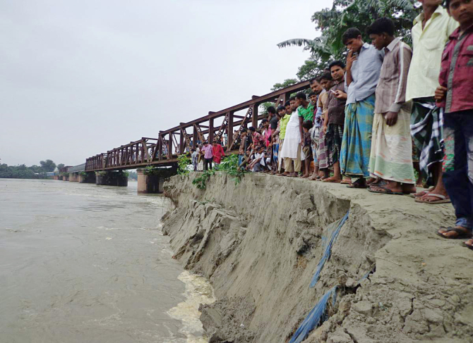 Erosion by the Dudhkumar River threatens Sonahat bridge in Bhurungamari upazila under Kurigram district. PHOTO: STAR