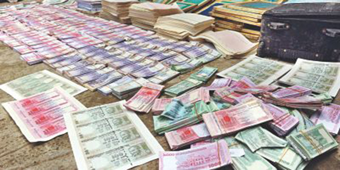 This October 14, 2012 photo shows counterfeit notes of taka and Indian rupee recovered from different areas in the capital.