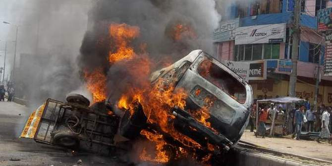 This Star photo taken May 20 shows a car of Phulgazi upazila chairman Ekramul Haque burning after an arson attack in Feni. The easy bike used by the attackers is also in flames.