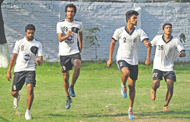 Mohammedan players limber up for a practice session at the club's ground in Motijheel yesterday afternoon. The Black and Whites are preparing for the Modhumoti Bank Independence Cup football tournament final against Feni Soccer Club tomorrow at the Bangabandhu National Stadium. PHOTO: STAR