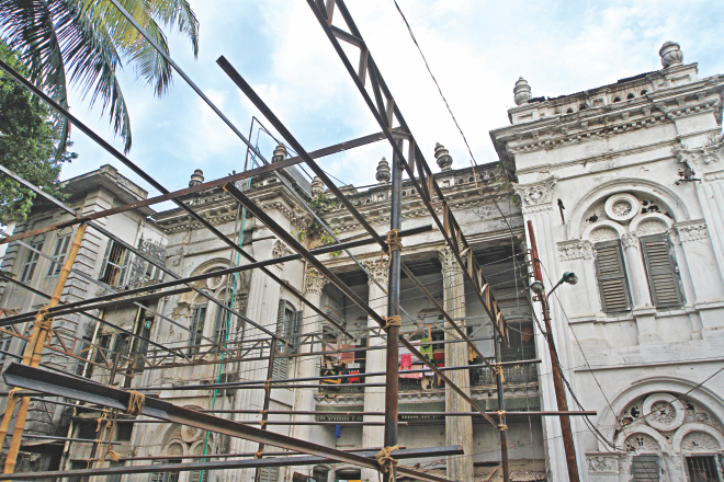 Scaffoldings are in place for building a garage for fire engines in front of the century-old mansion in Sutrapur of Old Dhaka. The photo was taken yesterday. Photo: Palash Khan
