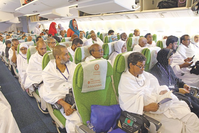 Pilgrims in the first Hajj flight at Hazrat Shahjalal International Airport of the capital yesterday. A Boeing 777-300ER  of Biman Bangladesh Airlines took off with 409 pilgrims on schedule, at 7:05am. The Hajj flight operations will continue till September 28. Photo: Star