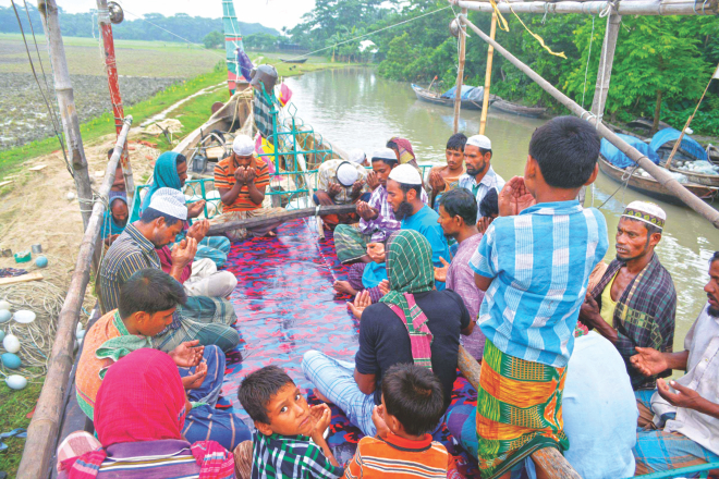 Fishermen offer special prayers on their boat at Char Wadel in Patuakhali yesterday following poor hilsa catch. Even though this is the peak of the season, their catch has been appalling spiraling hilsa prices in the kitchen market.  Photo: Star
