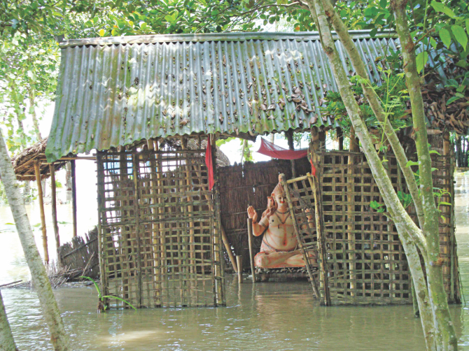 A temple goes under water at Etapota of Lalmonirhat yesterday as the northern region continues to suffer floods. Photo: Star