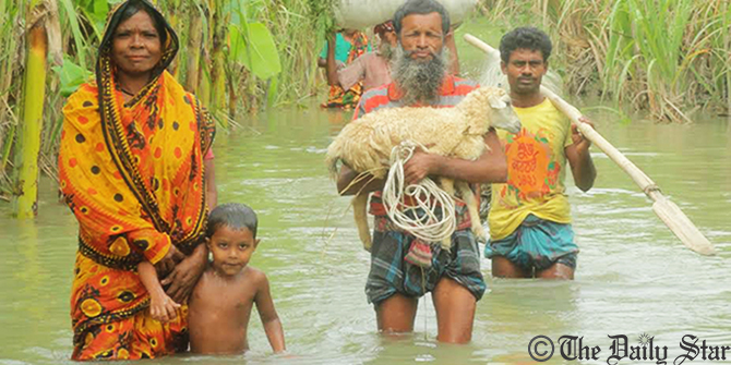 Affected people going to mainland at Char Shiberkuti village in Lalmonirhat Sadar upazila through knee to waist-deep water on a street. Photo: Star