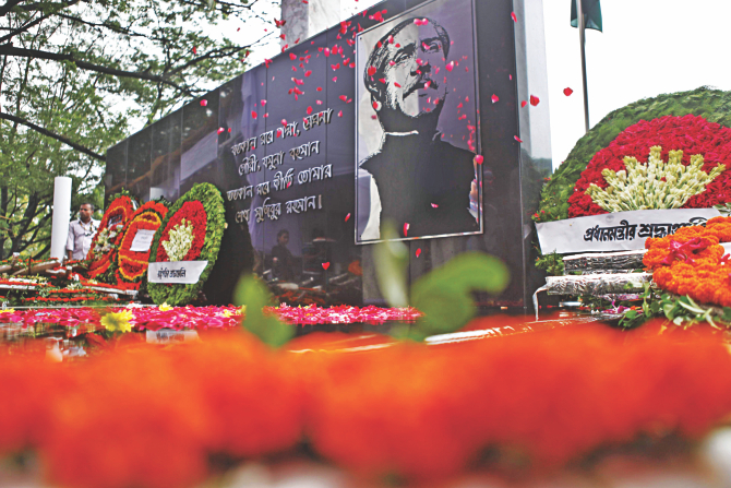 Floral wreaths placed by the president, the prime minister and socio-political leaders and organisations at the mural of Bangabandhu Sheikh Mujibur Rahman opposite to the historic Dhanmondi-32 house on the occasion of National Mourning Day yesterday. Photo: Rashed Shumon