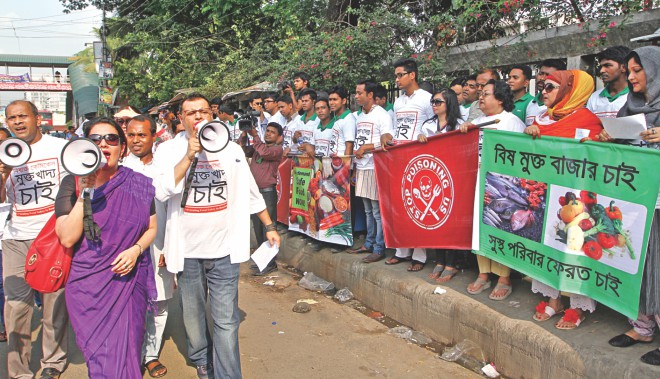 Volunteers chant slogans against food adulteration using megaphones during a human chain organised by a community group in front of the capital's Jatiya Press Club yesterday. The group arranged the programme demanding strict enforcement of food safety laws. Photo: Star