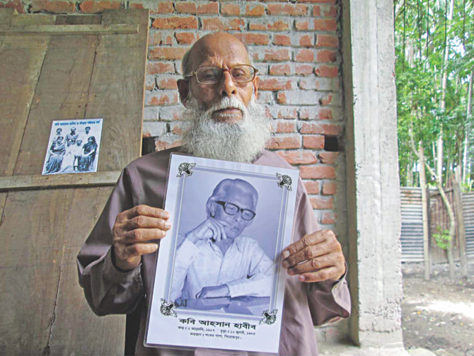 Golam Kobir, brother of Ahsan Habib, holding the poet's picture. Photo: Star